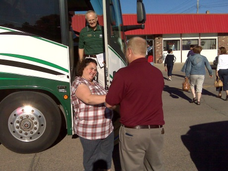 Cooperstown Mayor Carl Sad welcomes Rachel Navarro, UND assistant professor of counseling psychology, to the first stop on the bus tour: the Coachman Inn in Cooperstown, ND